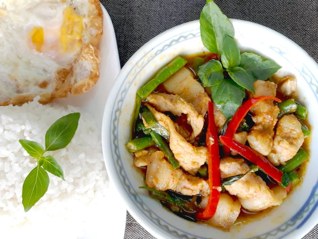 Image of spicy Thai Style Stir Fried Pork with long bean and chilli served with rice prepared by home chef