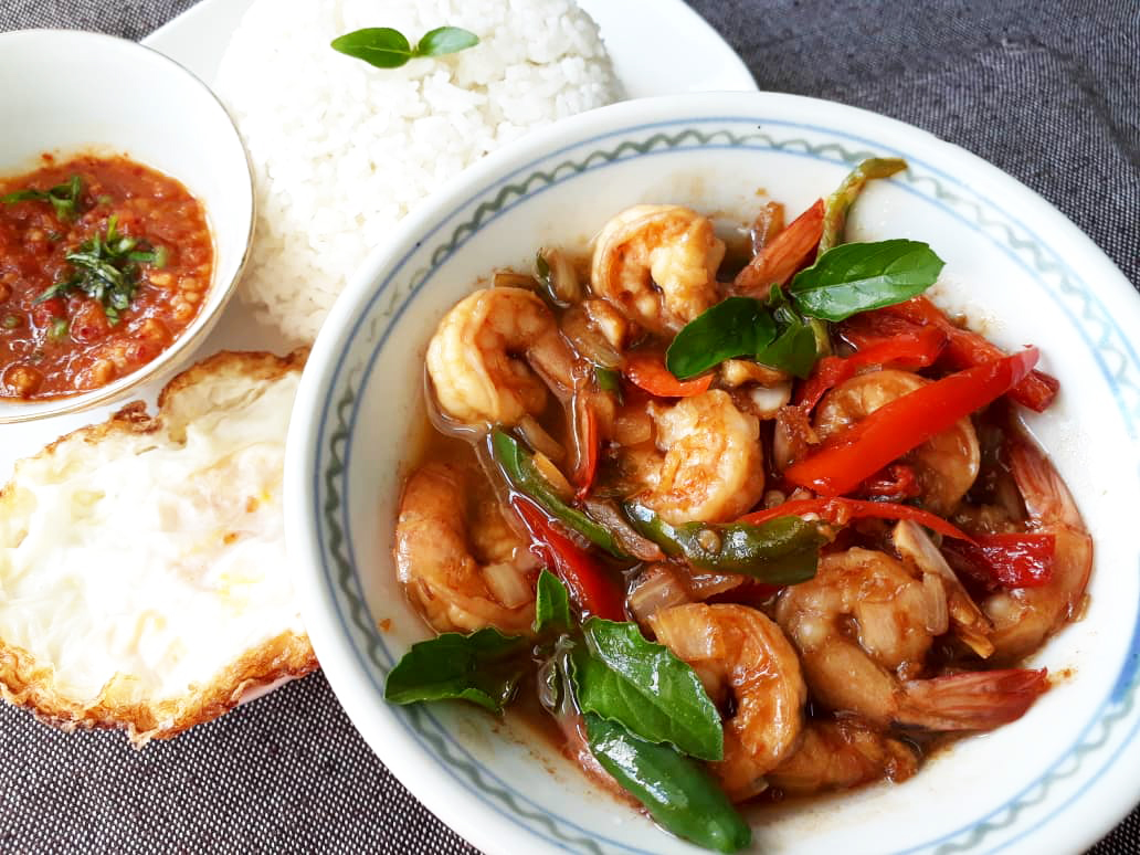 Image of delicious Stir Fried Prawn cooked with Thai Basil and Chilli served with rice prepared by home chef