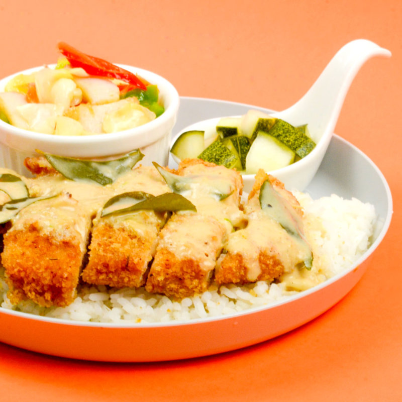 Image of luscious Creamy-Salted Egg Yolk Chicken chop served with rice and pickled radish