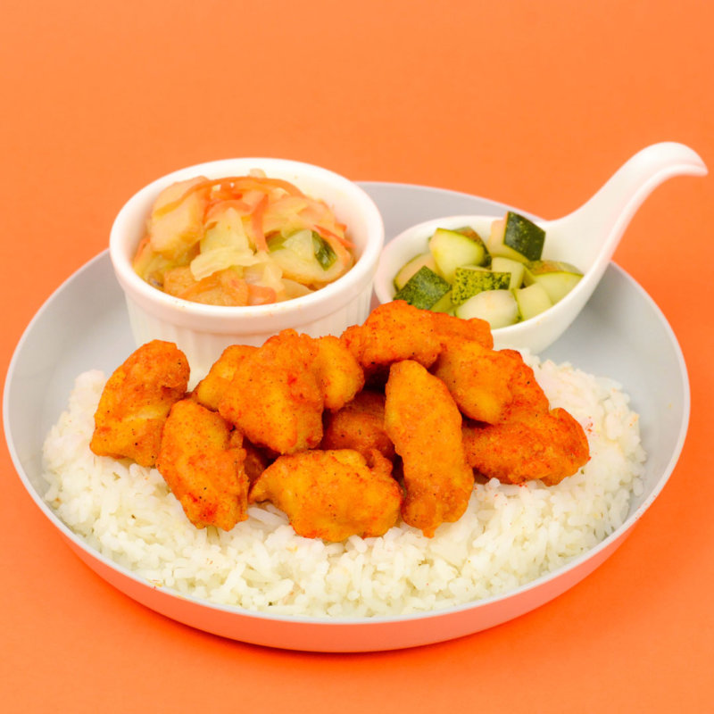 Image of scrumptious Taiwan Popcorn Chicken served with rice, pickled vegetable and tomato soup