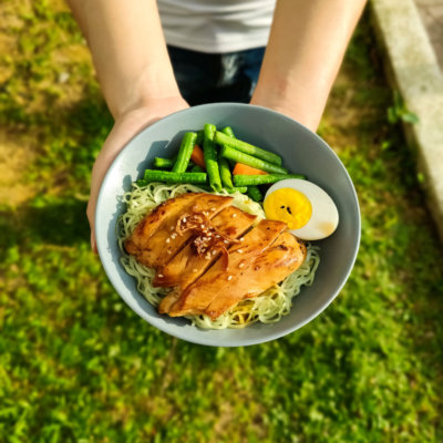 Image of delicious Hong-Kong Style Glazed Chicken Noodles served with long bean and hard-boiled egg